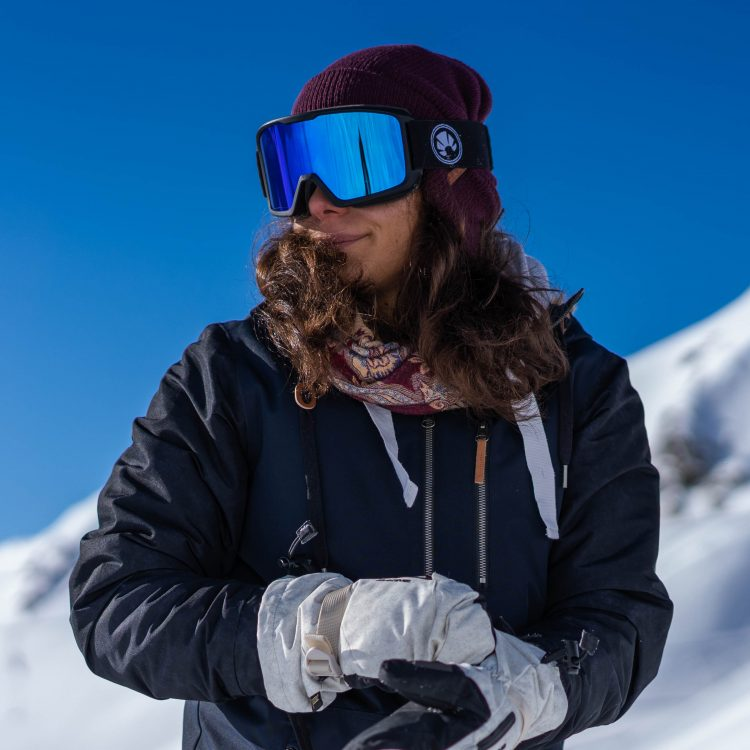 Blue snowboard goggles for a sunny day